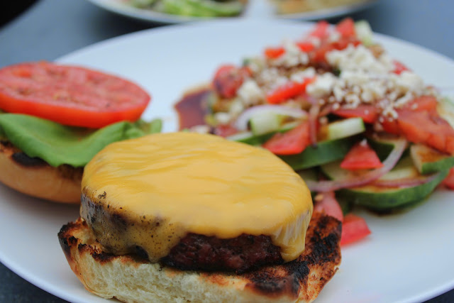 Cheeseburger with cucumber salad