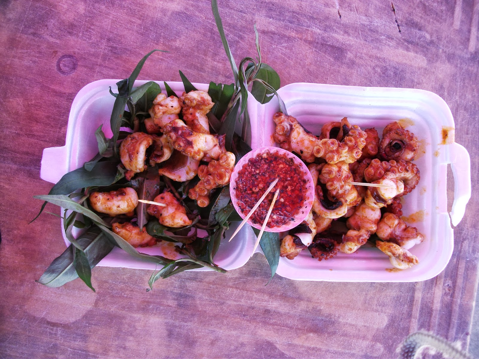 eating octopus with chilly sauce in vung tau, vietnam