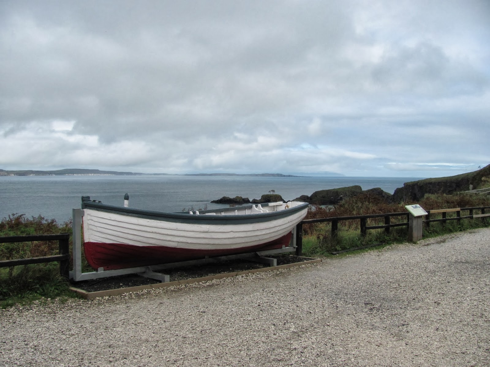 A small rowboat is on display on the Antrim Coast