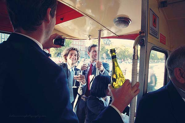 guests having fun and drinking on a red routemaster wedding bus