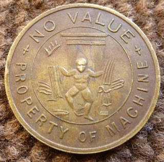 A Loaned for Amusement Only, No Value, Property of Machine brass machine token