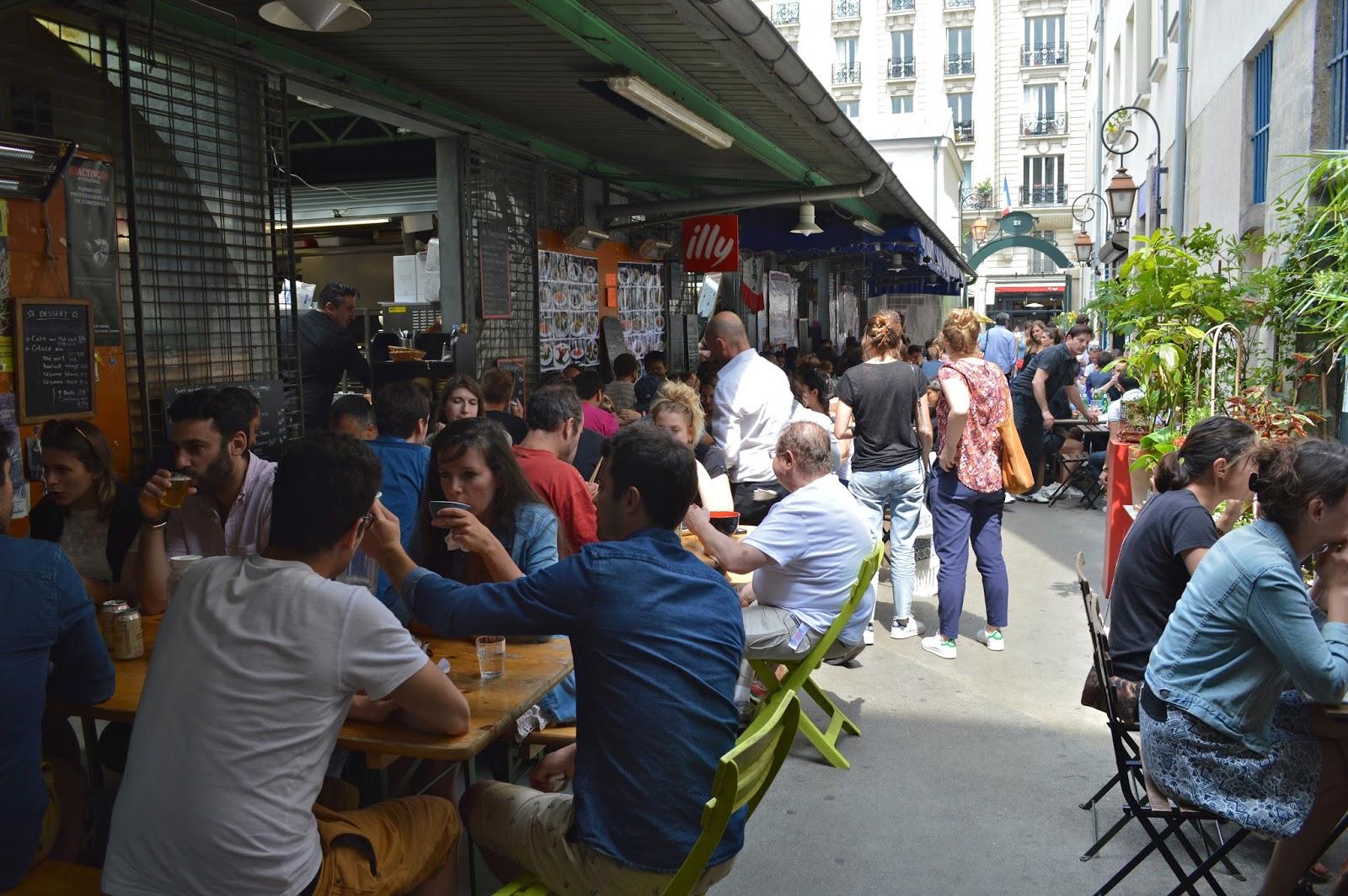 Parisians eating outdoors at Marché des enfants rouges Paris