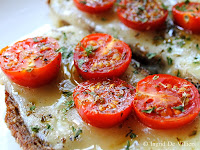 Wheat Five Grain Italian Toast With Broiled Garlic, Marmite, Cheese, Tomatoes, Olive Oil and Herbs