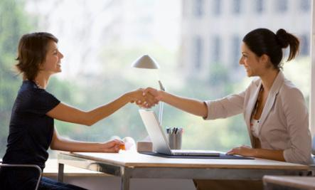 4 Surprising Things Your Body Language Is Saying   - two woman girls shake hands meeting women