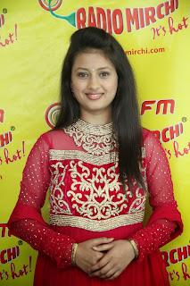 Kanika Tiwari Cute Beauty in Red Dress at Radio Mirchi Hyderabad