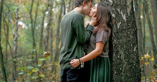 Kiss Hug Romantic Charming Couple In Forest Tree
