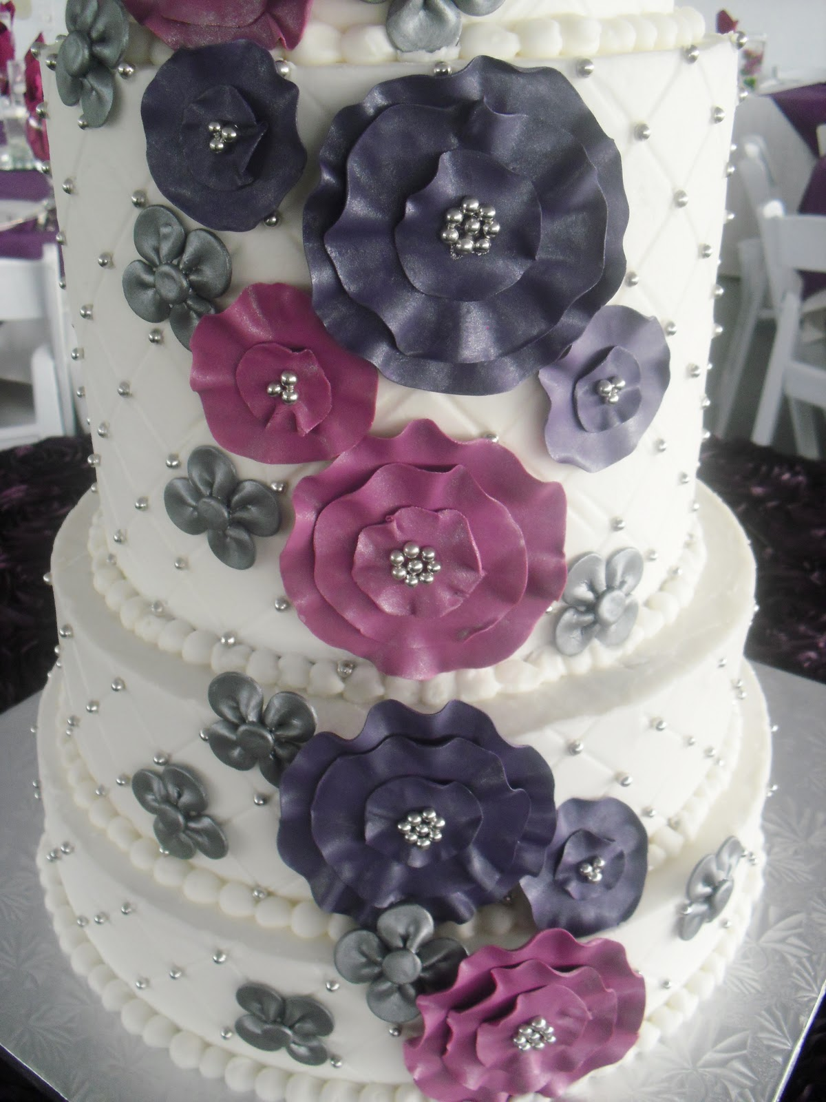 Made Fresh Daily Pink And Purple Floral Wedding Cake
