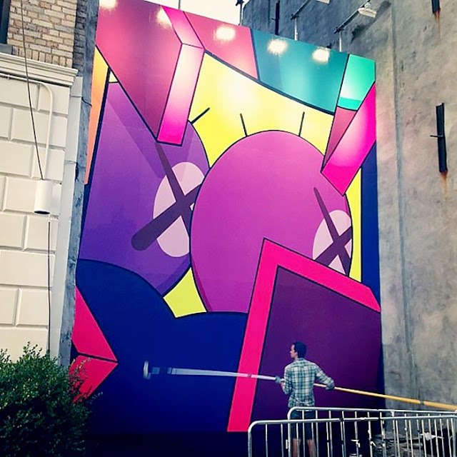 Street Art Mural By KAWS in Brooklyn, New York City. work in progress