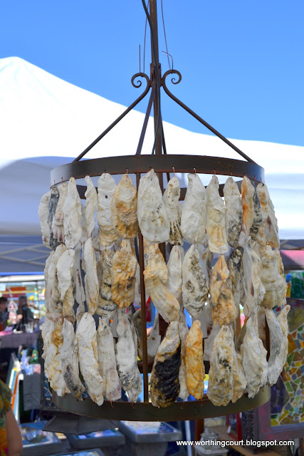 chandelier made with oyster shells via Worthing Court blog