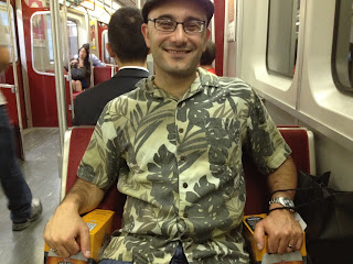 Dan with his sample six-packs on the subway ride home.