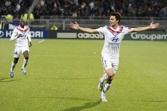 Lyon player Clément Grenier celebrates after scoring his side's second goal against Rennes