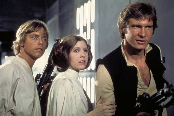 Mark Hamill, Carrie Fisher and Harrison Ford playing in Star Wars