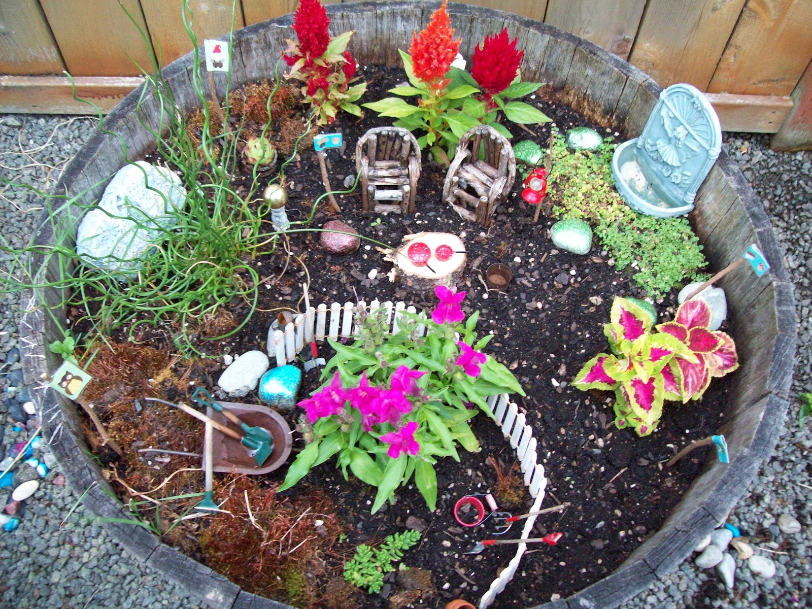Fairy garden ornaments - Earlier This Year My Hubby Was Helping His Great Aunt Move And She Passed Along Some Fun Garden Ornaments To Us One Of The Items Was This Cute Little
