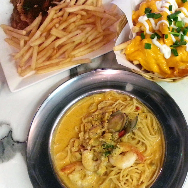 49 Seats tom yam seafood pasta cheese fries