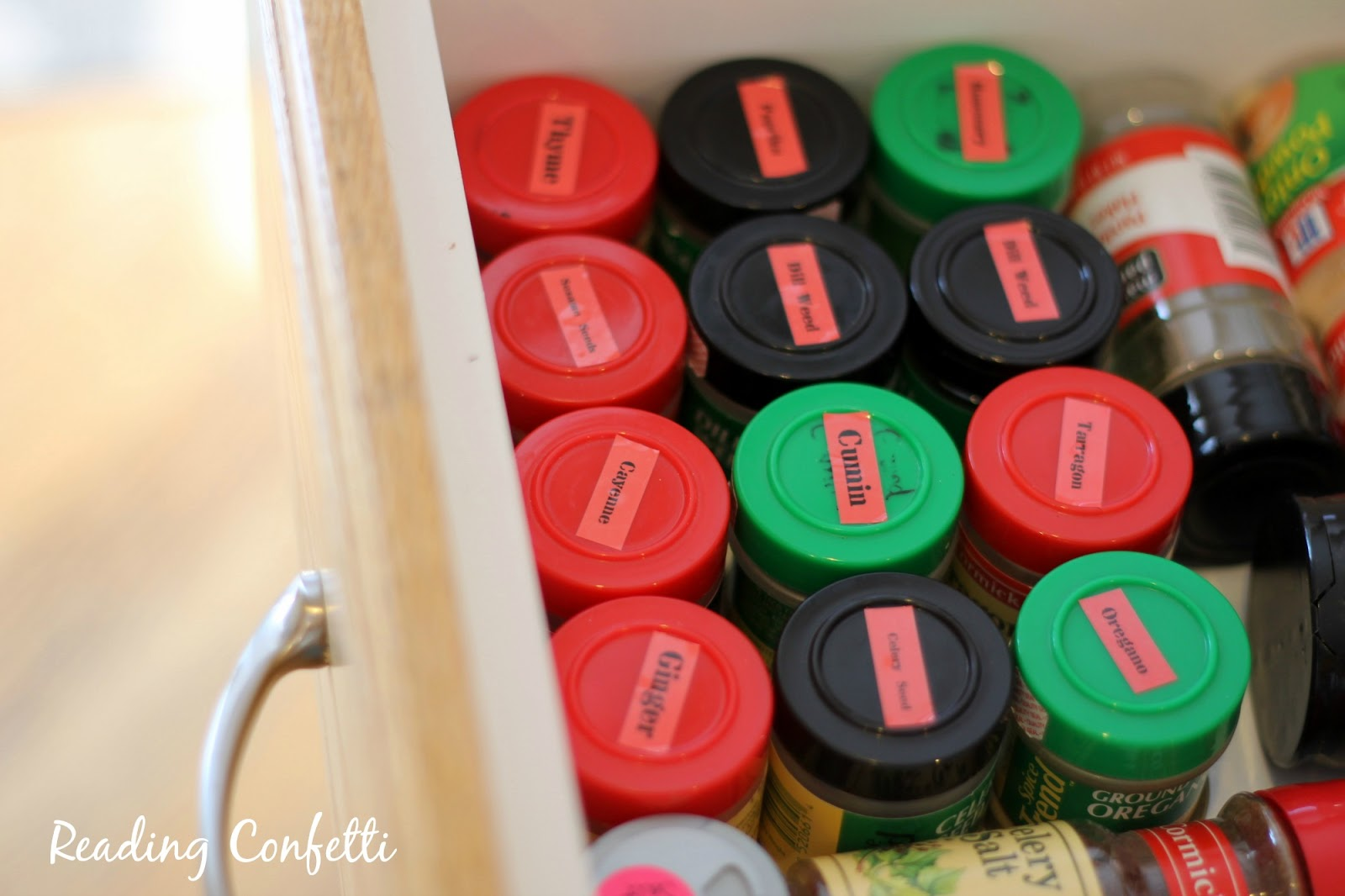 Labeled spices stored in a drawer