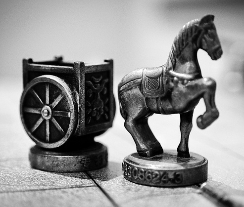 Two chess pieces of a horse and a chariot