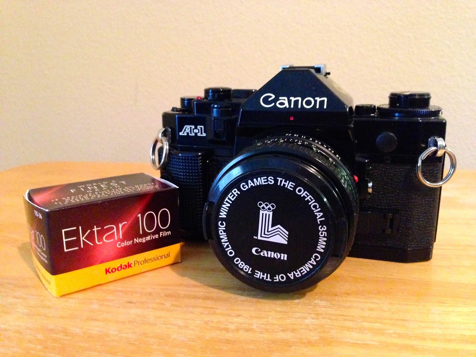 Canon A-1 with box of Kodak Ektar 100 film