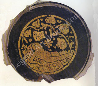 Gold glass portraying jnab beneath a ground plant fourth century biblioteca Vaticana Rome