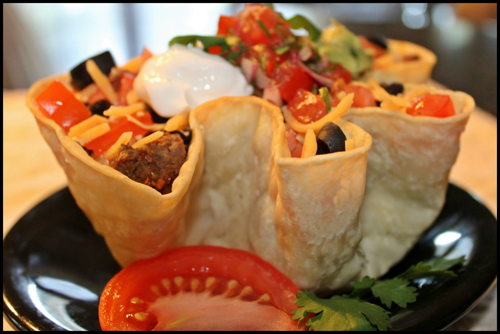 taco salad the tortilla bowl is made from this vegan taco salad in a ...