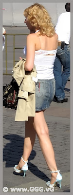 Girl in denim skirt on the street