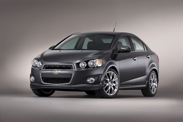2013 Chevrolet Sonic Dusk Photos (  2013 Chevrolet Sonic Dusk, 2013Chevrolet-Sonic-Dusk )Announced prior to the 2012 SEMA show, Chevrolet's SEMA concept car, Sonic Dusk sedan, will start production and be available in the 2014 calendar year. Sonic Dusk shows a production-intended package that includes ground effects, a rear spoiler and large, 18-inch aluminum wheels with a Pearl Nickel finish. They lend the Ashen Grey Sonic Dusk sedan a contemporary aesthetic that is refined and stylish.