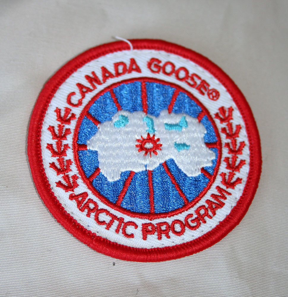 canada goose logo fake vs real