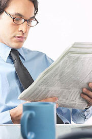 commercial real estate agent reading newspaper