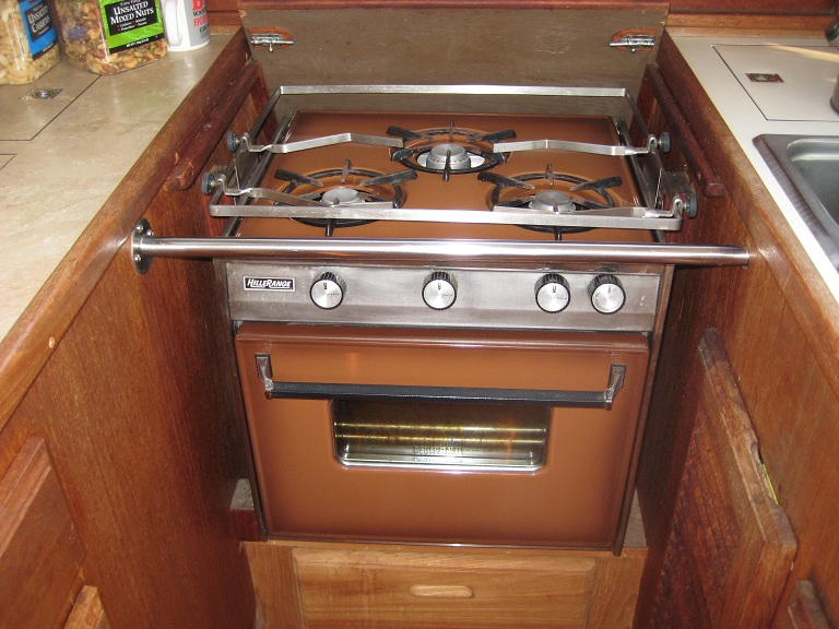 Here is the old range. The stove top burners worked OK but the oven ...
