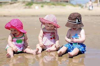 cute babies playing on beach cover photo for facebook