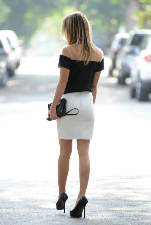 Black blouse, white skirt and black hand bag for ladies
