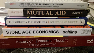 Stack of books for the course