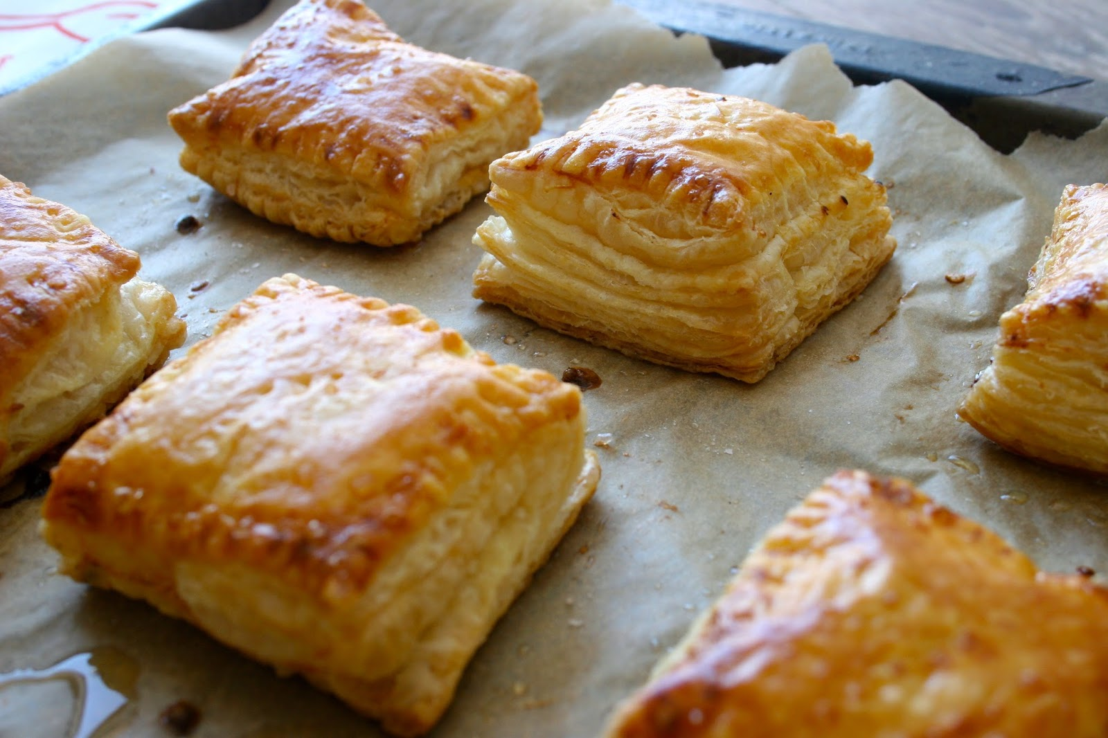 Puff Pastry Hand Pies with Goat Cheese & Hot Pepper Jelly on baking sheet