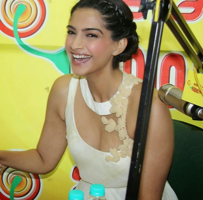 sonam kapoor cleavage at radio mirchi in white bra gown hot pics snapped