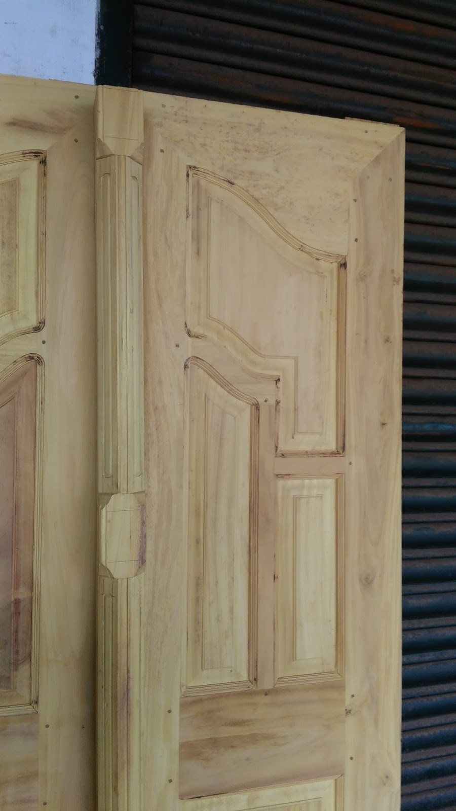 Kerala style carpenter works and designs november 2015 for Wooden double door designs for main door