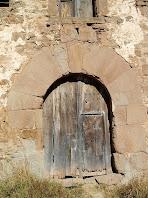 Portal adovellat del mas El Prat
