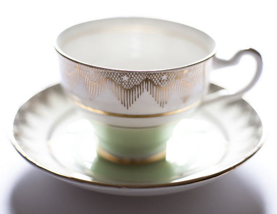 green and gold star vintage teacup
