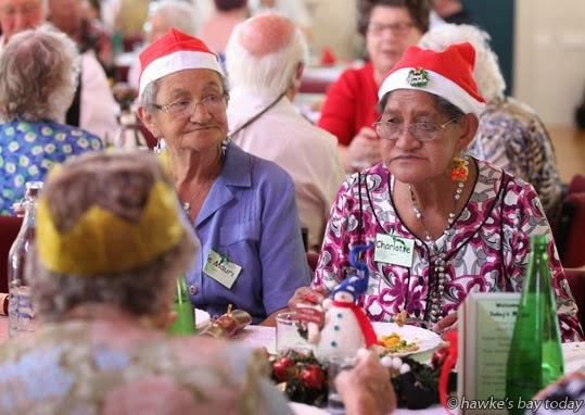 L-R: Te Mauri Tawhai, Charlotte Lawrence, both from Greenmeadows, Napier, at a free community lunch on Christmas Day, at All Saints Taradale, in Taradale, Napier. photograph