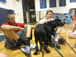 Tyler and Hinton gets some puppy time with Coach after the tour.