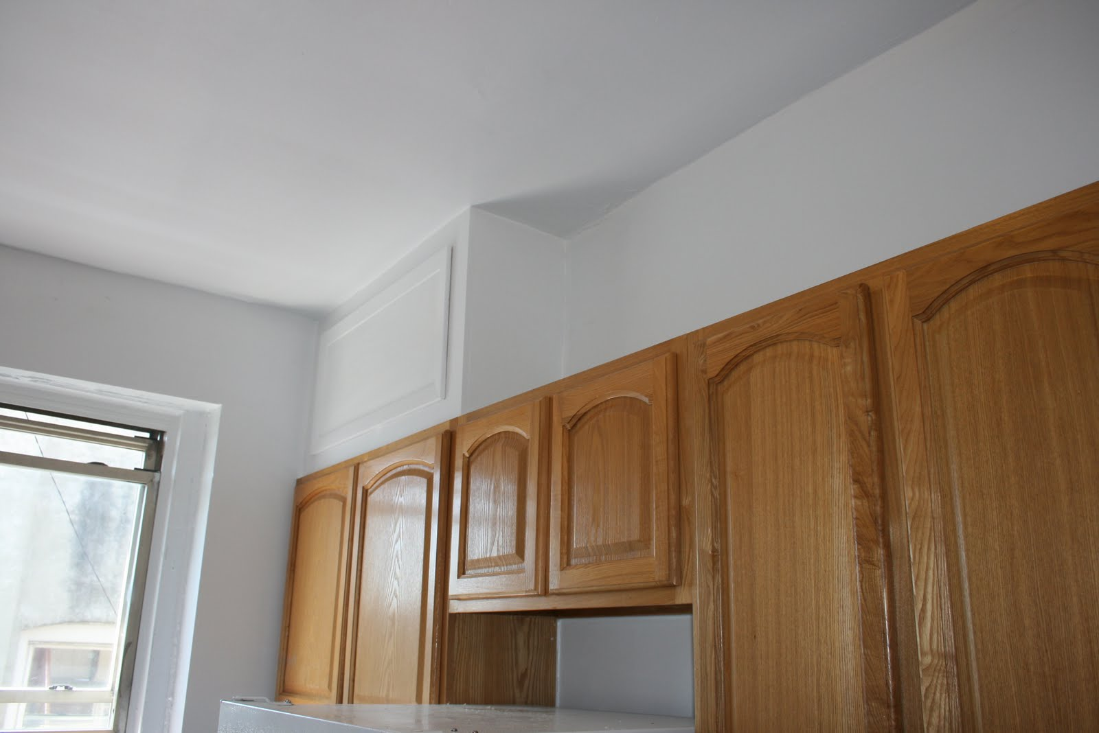 Kitchen designs cabinets to cover kitchen pipes.