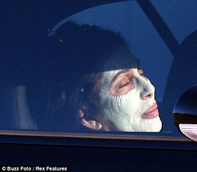 Cher sporting a white face mask