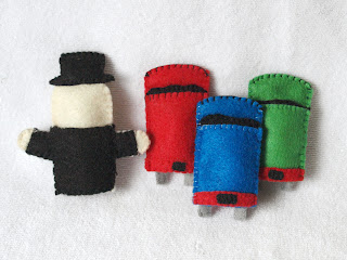 Back view of Thomas the Tank Engine felt finger puppets handmade by Joanne Rich.