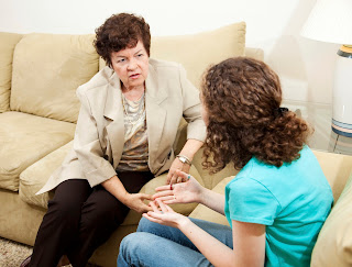 Photo a a counseling session with a teenaged girl.