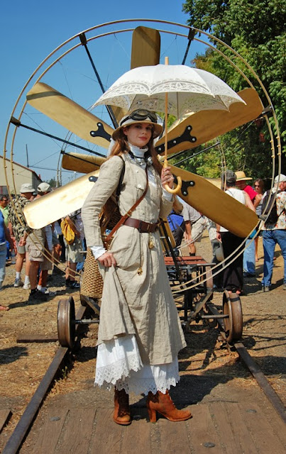 steampunk clothing (womens clothing, hat, goggles, dress, coat, boots, parasol)