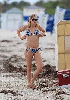 Doutzen Kroes shows off her curves in a  New Bikini at Sandy Miami beach