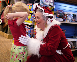 Child meeting Mrs. Claus at Santa Land at Bass Pro Shops