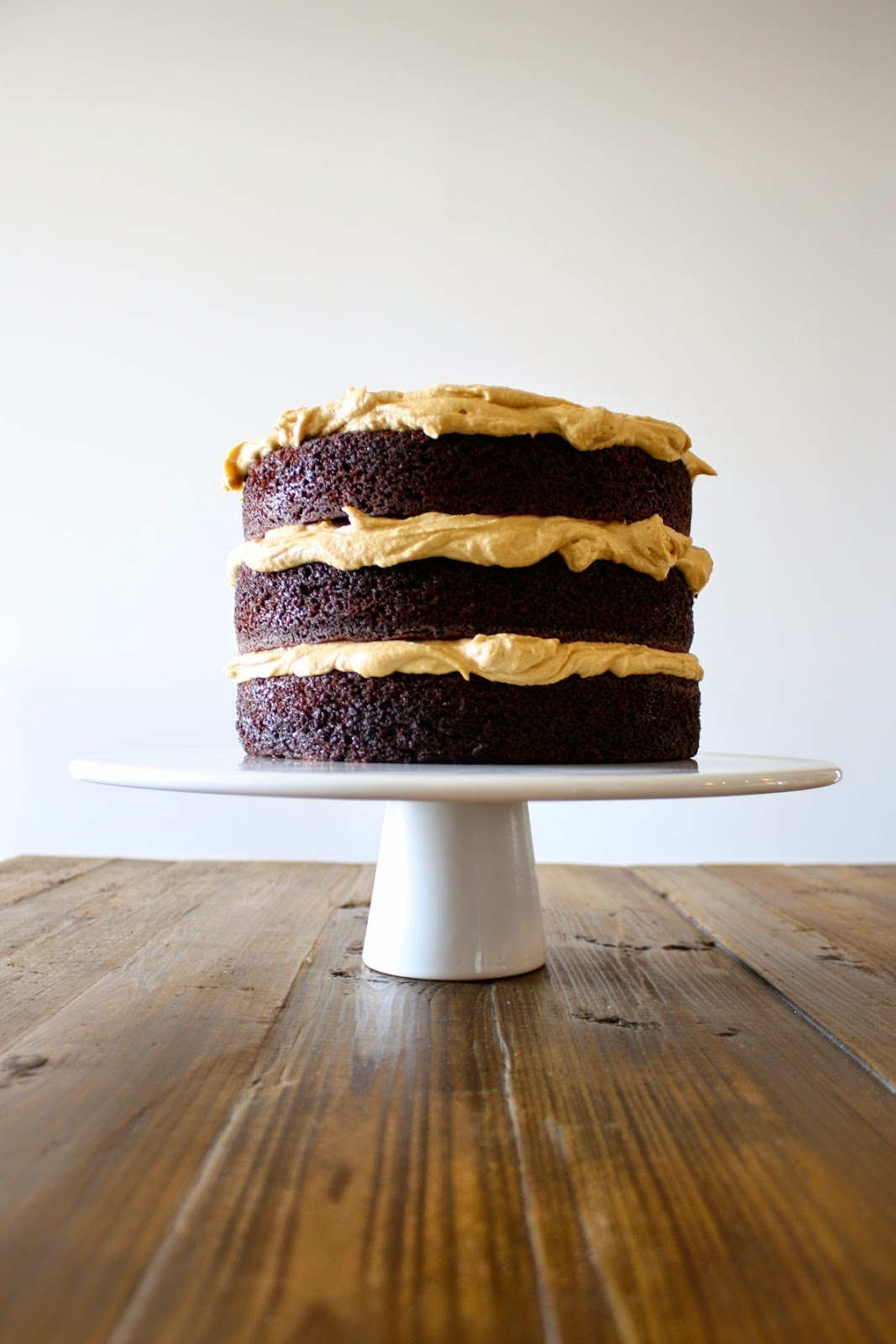 Reese's Peanut Butter Chocolate Cake - Rich and delicious chocolate cake with a whipped peanut butter frosting and mini Reese's peanut butter cups. | livforcake.com