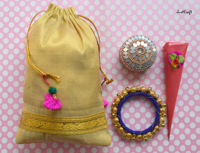 Potli, bangle, Mehendi cone and sindoor dibbi