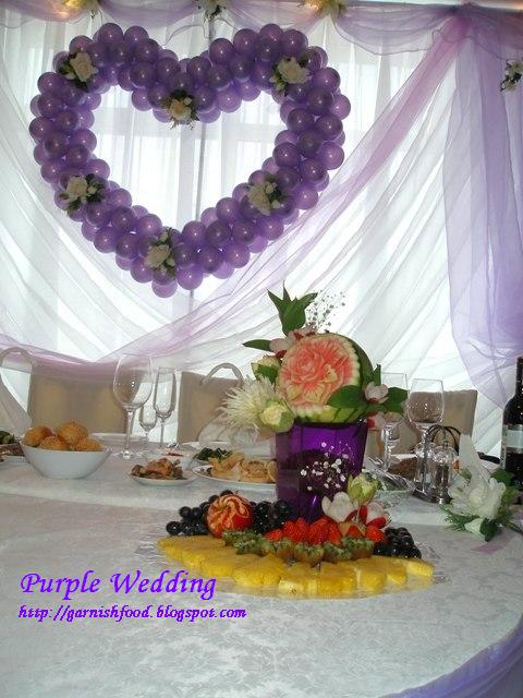 I made this fruit arrangement for a themed wedding decorated in purple color