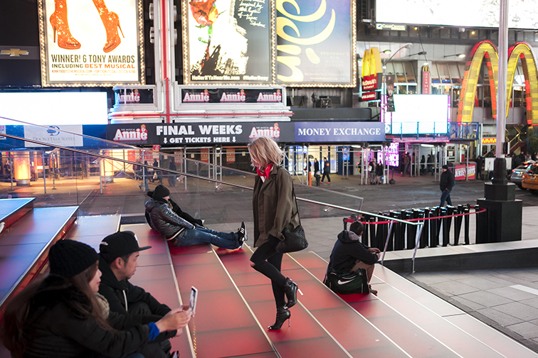 Nighttime Times Square, bright lights, blond bob, big city, skinny jeans, stiletto booties, TKTS staircase, fashion photography, photos by Ian Rusiana