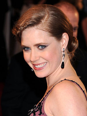 Amy Adams goes retro with a looping front braid and low chignon.